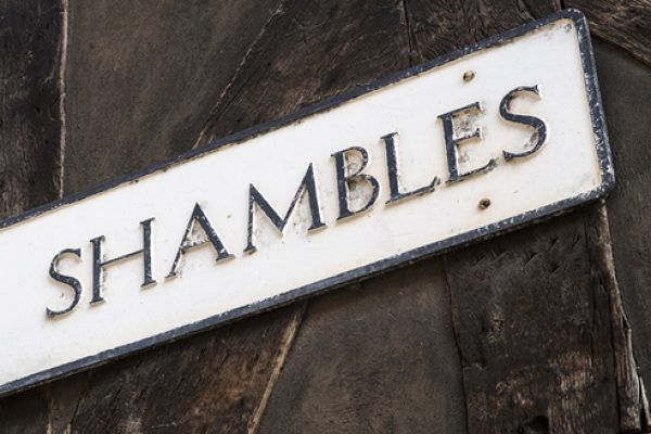 What does 'shambolic' mean?